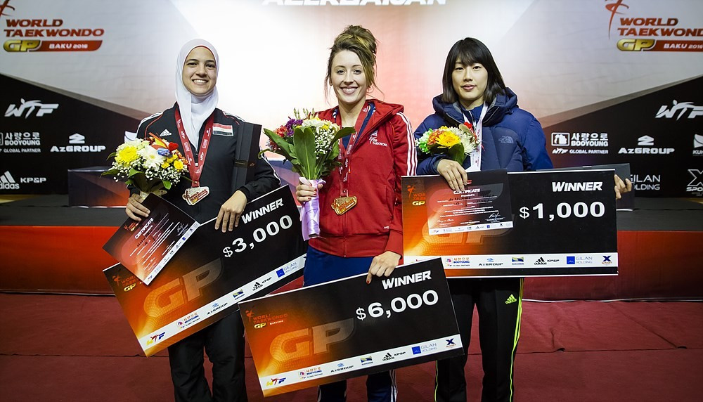 Jade Jones (centre) also won gold today for Great Britain, triumphing in the women's under 57kg category ©WTF