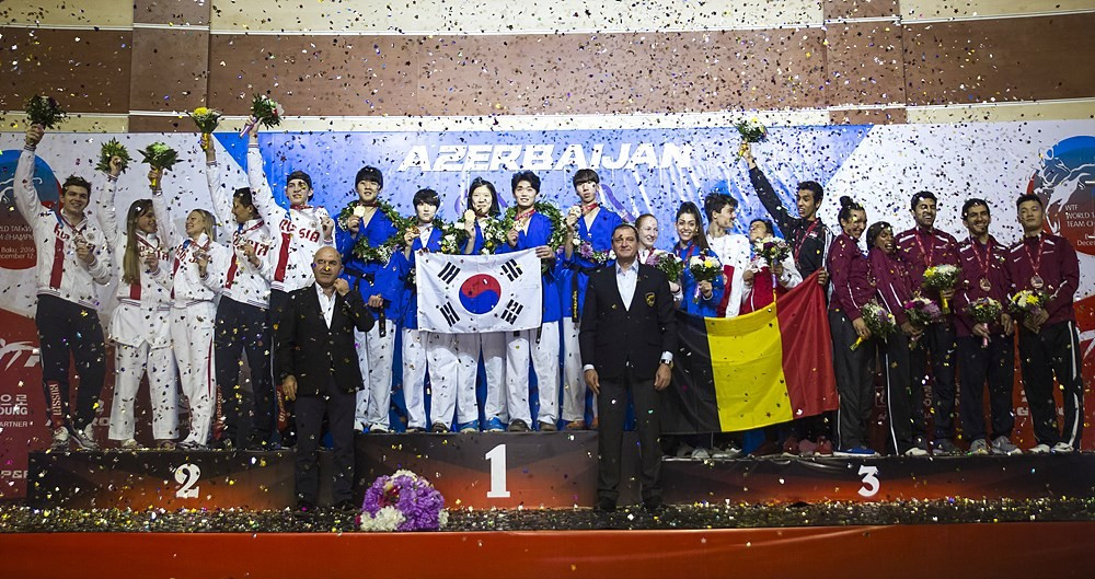 South Korea (centre) won the first mixed team title at the WTF Taekwondo Team Championships today ©WTF
