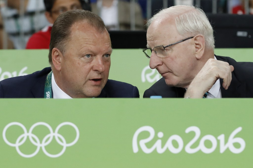 Patrick Hickey (right), seen speaking to International Judo Federation President Marius Vizer at the Rio 2016 Olympics, has left Brazil for the first time since the Games  ©Getty Images