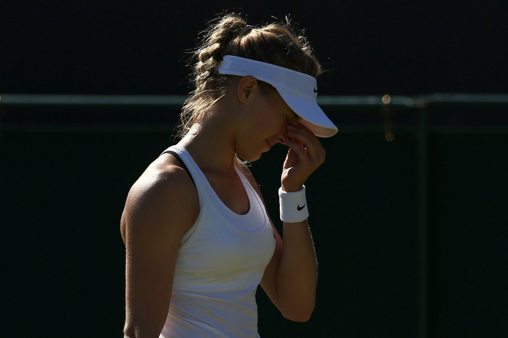 Bouchard's woes continue as 2014 finalist dumped out in Wimbledon first round