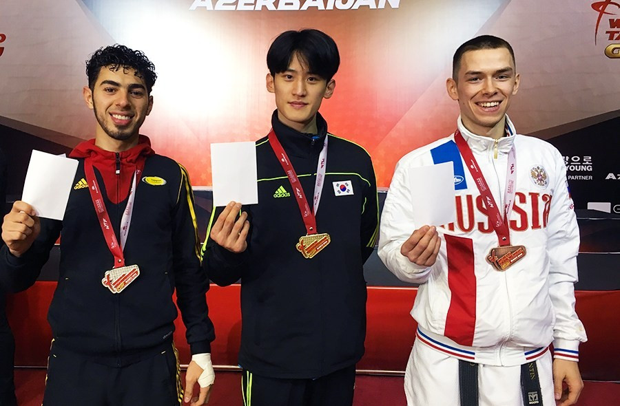 """Medallists at the WTF Grand Prix Final held in Baku in Azerbaijan held up white cards to show support for the """"Peace through Sport"""" initiative ©WTF"""