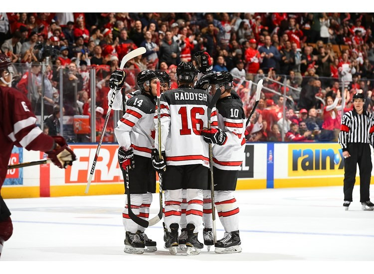 Canada ease past Latvia to set up crunch group B match with the United States