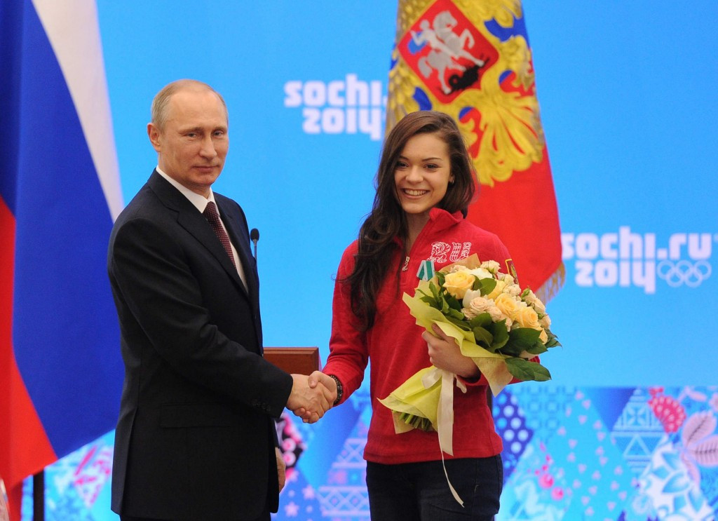 Adelina Sotnikova, right, with Russian President Vladimir Putin following her Olympic victory at Sochi 2014 ©Getty Images