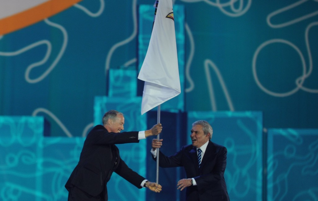 Lima Mayor Luis Castañeda Lossio (right) pictured receiving the PASO flag during the Closing Ceremony of the Toronto 2015 Games ©Getty Images