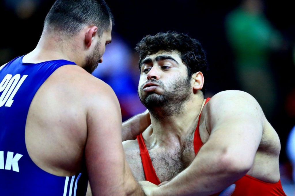 Bashir Asgari Babajanzadeh, right, is one of two athletes to be banned for four years ©UWW