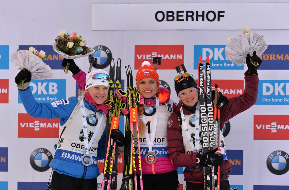 The Czech Republic's Gabriela Koukalová, centre, celebrates her latest World Cup victory today in Oberhof ©Getty Images