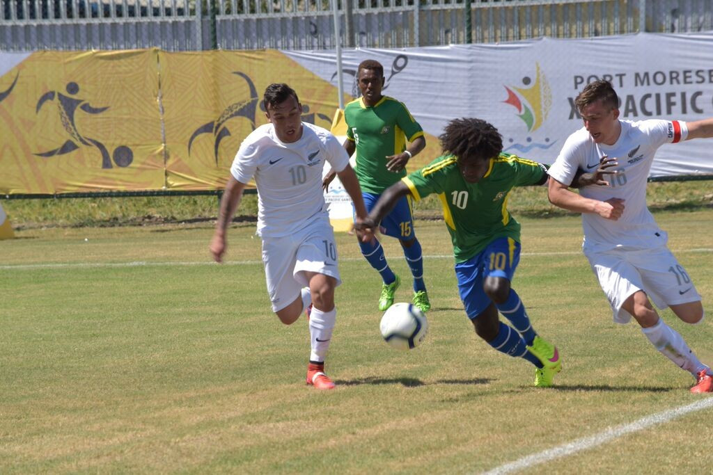 New Zealand got their football campaign off to a winning start as they beat the Solomon Islands in scorching temperatures in Port Moresby