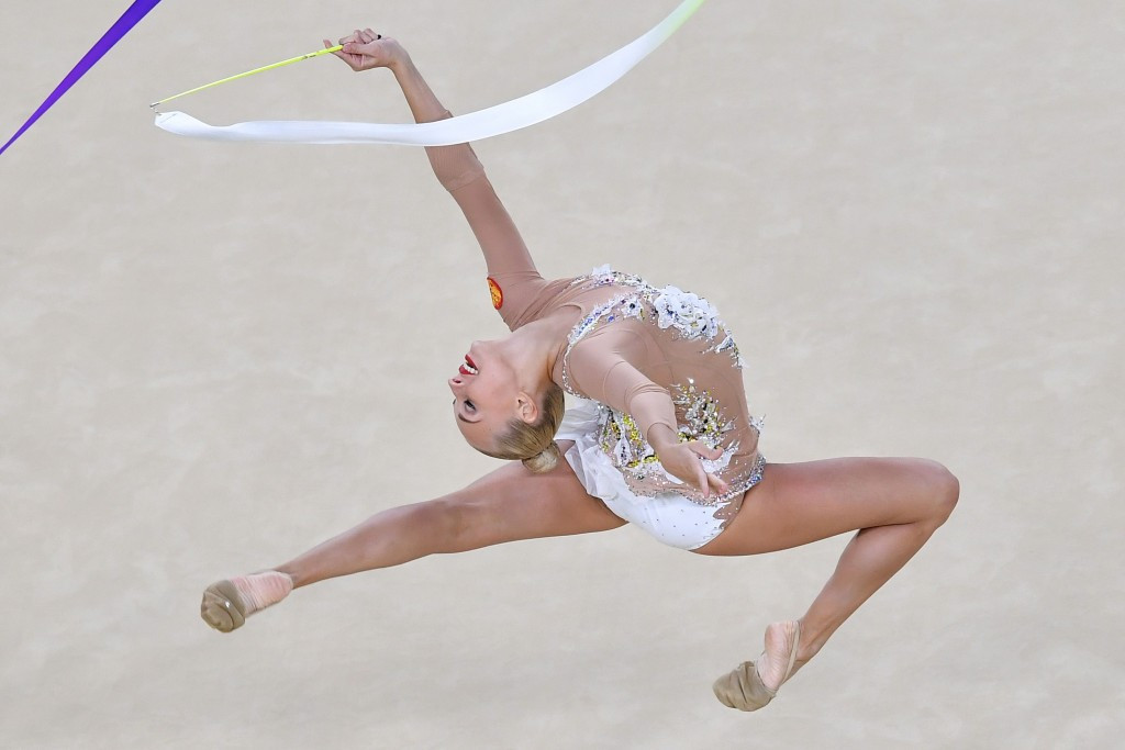 Thirteen-time rhythmic gymnastics world champion retires aged 19