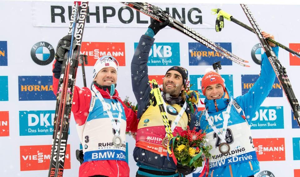 Martin Fourcade, centre, poses alongside his fellow podium finishers ©IBU