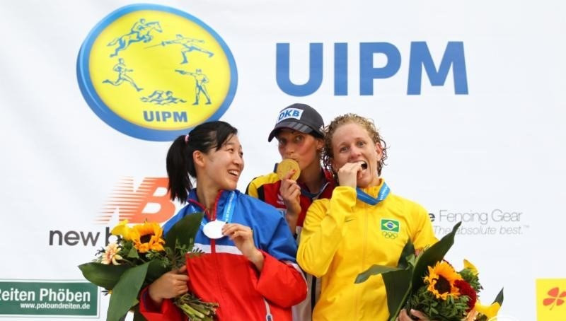 The podlum after the women's individual event at the Modern Pentathlon World Championships in Berlin - winner Lena Schoneborn centre, silver medallist Qian Chen of China (left) and Brazil's Yane Marques