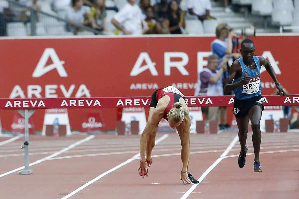 Evan Jager of the United States hits the deck after the final hurdle in the 3,000m steeplechase in Paris before getting back up to run the second best time of 2015 behind Kenya's eventual winner Jairus Kipchoge Birech