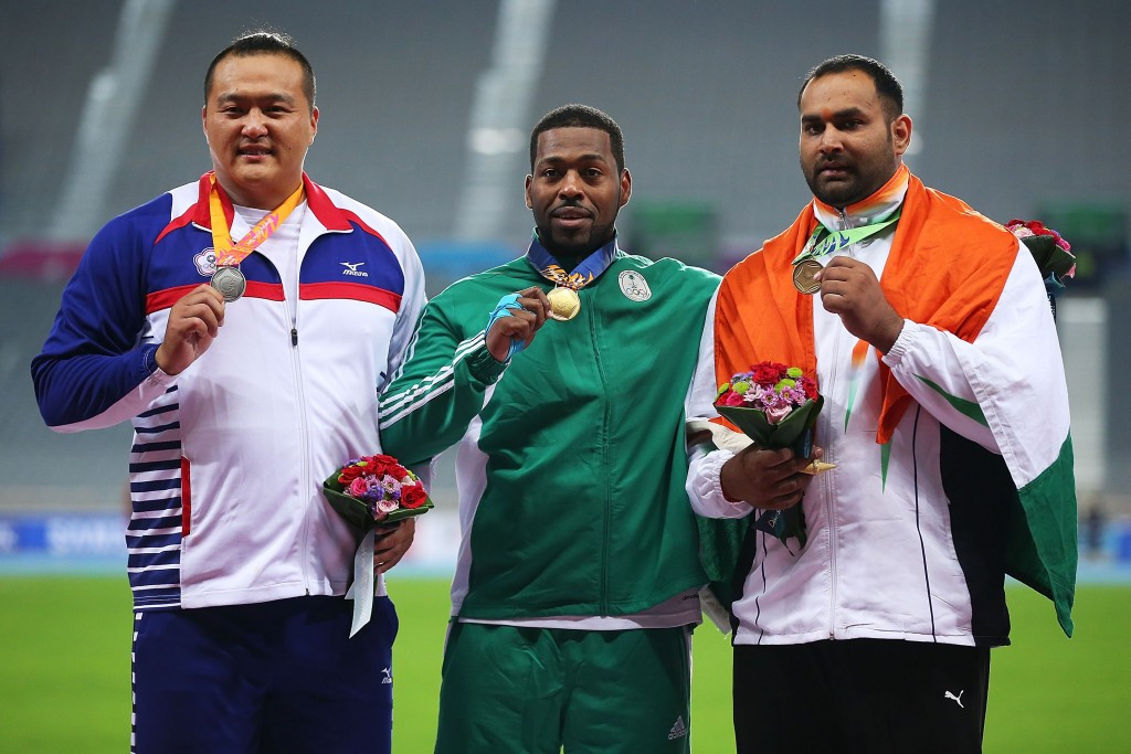 Inderjeet Singh, right, won shot put bronze at the 2014 Asian Games in Incheon ©Getty Images
