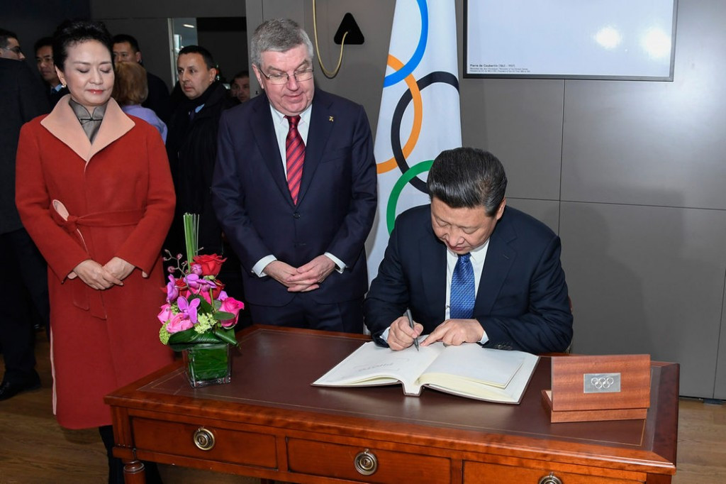 Xi Jinping pictured signing the IOC visitors book at the end of his meeting today ©IOC
