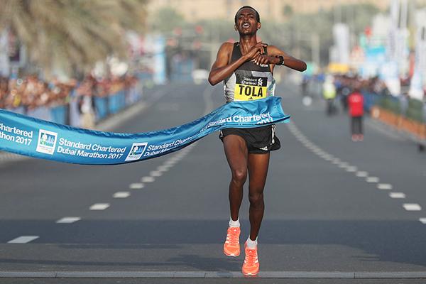 Tola wins Dubai Marathon after Bekele falls