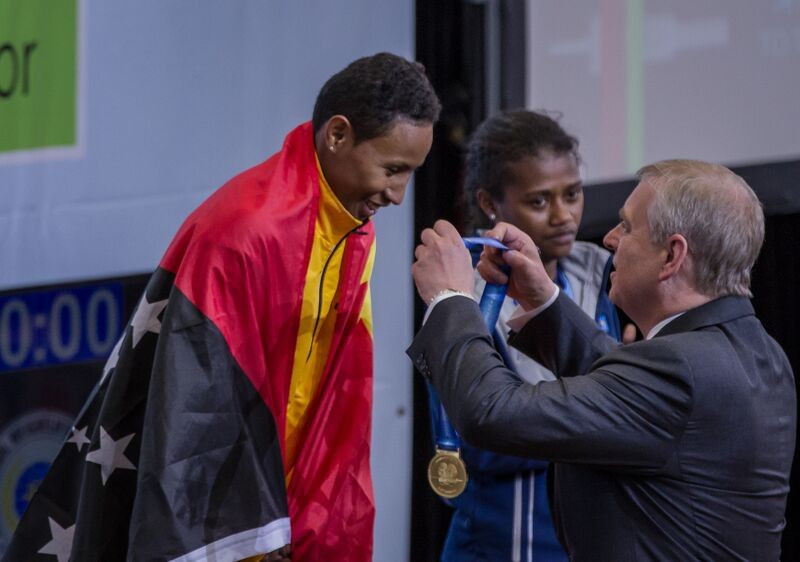 Papua New Guinea's Thelma Mea Toua received her three gold medals from Duke of York Prince Andrew