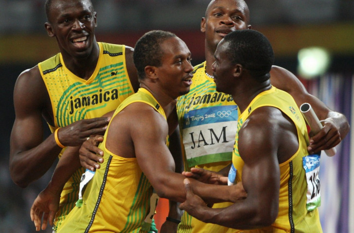 Usain Bolt, left, celebrates victory in the 4x100m final at Beijing 2008 with colleagues Michael Frater, second left, Asafa Powell, second right, and, right, Nesta Carter, whose positive drugs test has now annulled the result ©Getty Images