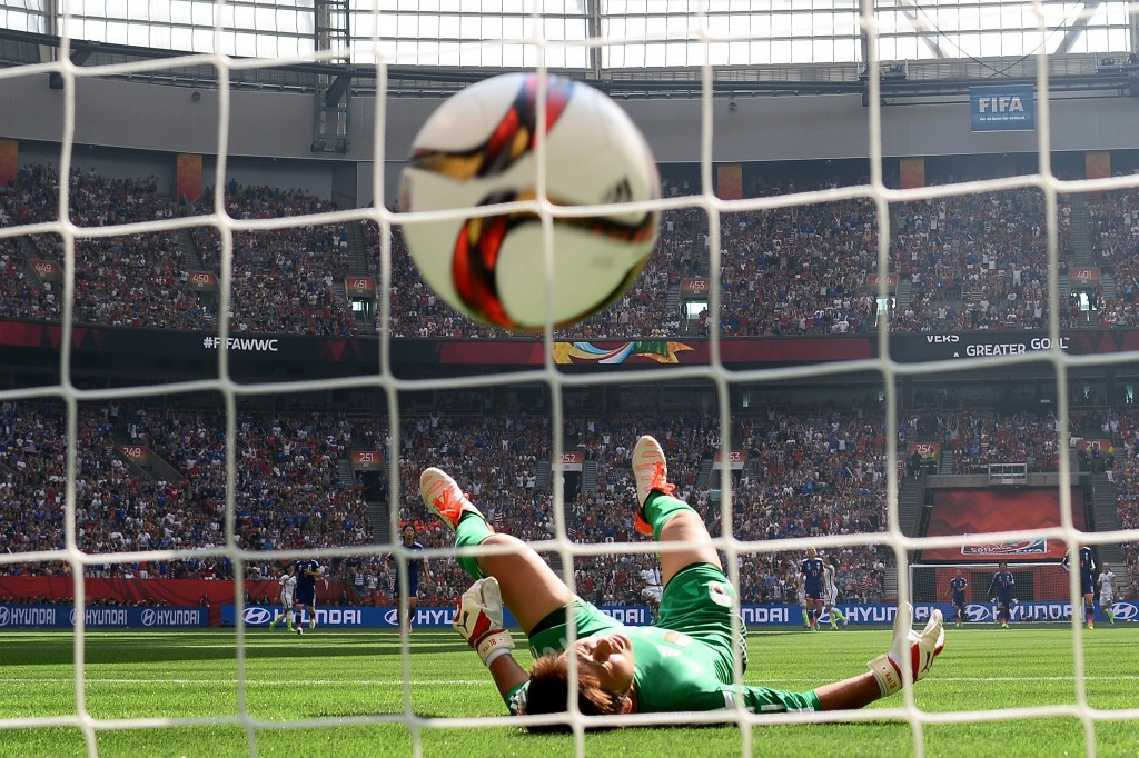 American midfielder Carli Lloyd's audacious attempt from just in front of the halfway line sealed her hat-trick and embarrassed Japan 'keeper Ayumi Kaihori