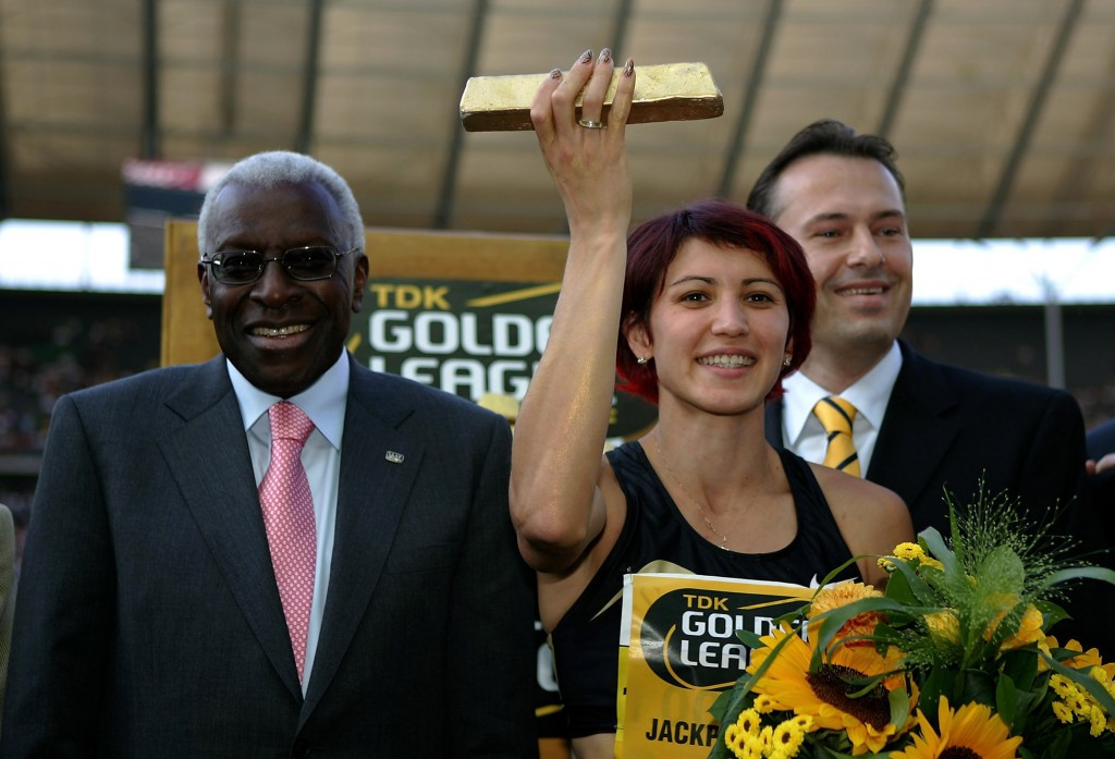 Russia's Tatyana Lebedeva, right, pictured with former International Association of Athletics Federations President Lamine Diack in 2005 ©Getty Images