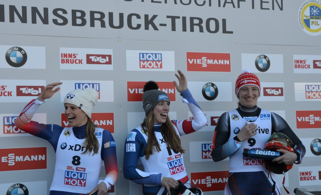 Erin Hamlin, centre, claimed a surprise world title today ©FIL