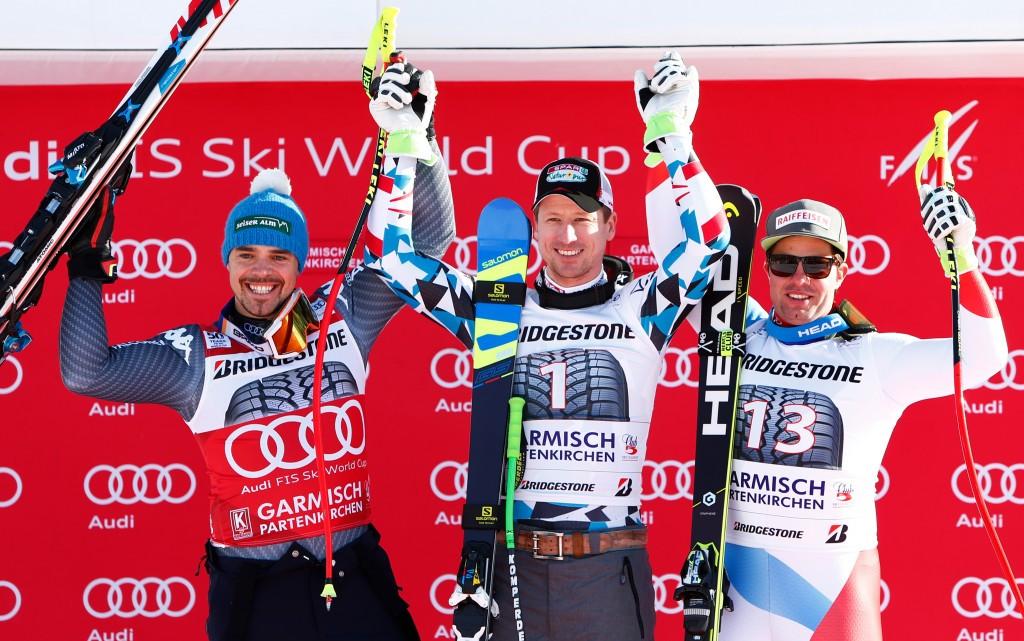 Peter Fill of Italy, left, Austria's Hannes Reichelt, centre, and Swiss skier Beat Feuz celebrate after making the podium in Garmisch-Partenkirchen ©Getty Images