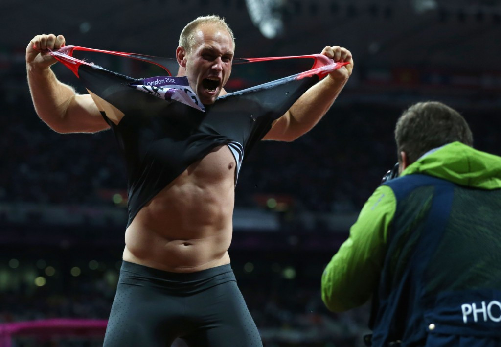 Robert Harting does his famous vest rip after winning gold at the 2012 Olympic Games in London ©Getty Images