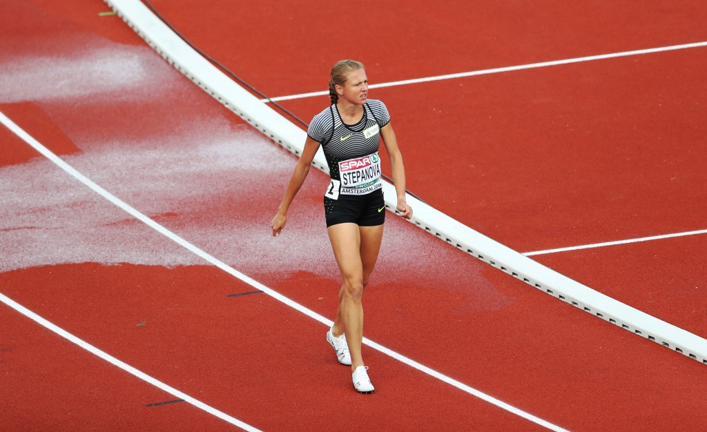 Yuliya Stepanova pictured walking on the track in pain after struggling with injury when competing at July's European Championships in Amsterdam ©Getty Images