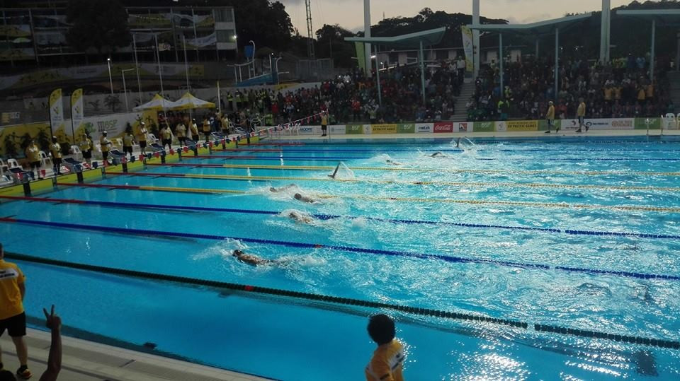 Four Pacific Games records were broken in the evening session on the opening day of swimming action at the Taurama Aquatic Centre