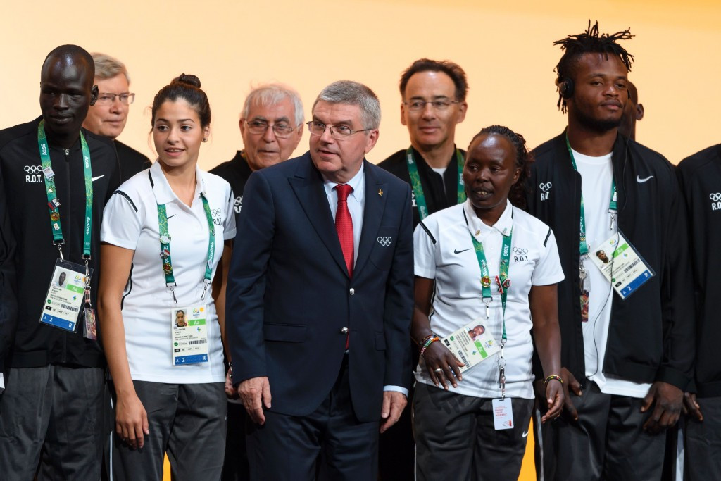 IOC President Thomas Bach posed with members of the Refugees Olympic Team at Rio 2016 ©Getty Images