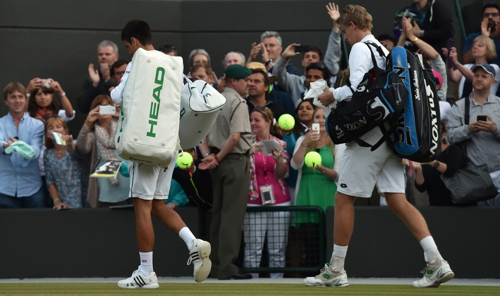 Djokovic fightback halted by bad light as Wimbledon enters second week