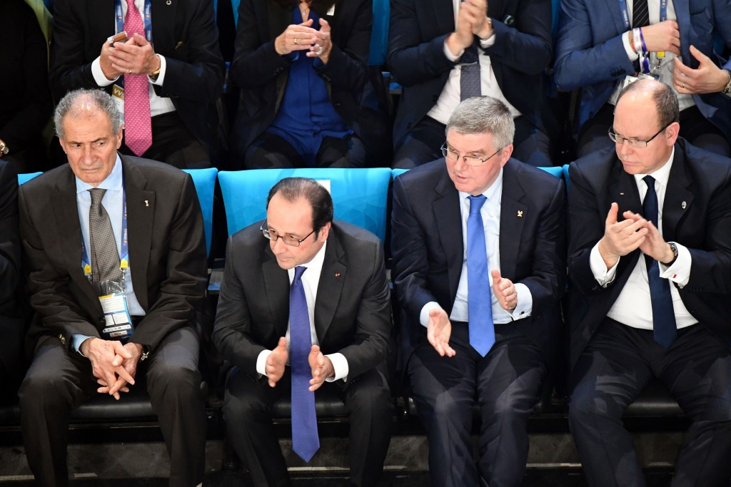 IOC President Thomas Bach, second right, watches the IHF Men's World Championship Final in Paris with French President Francois Hollande, second left, and Prince Albert II of Monaco, right ©Getty Images