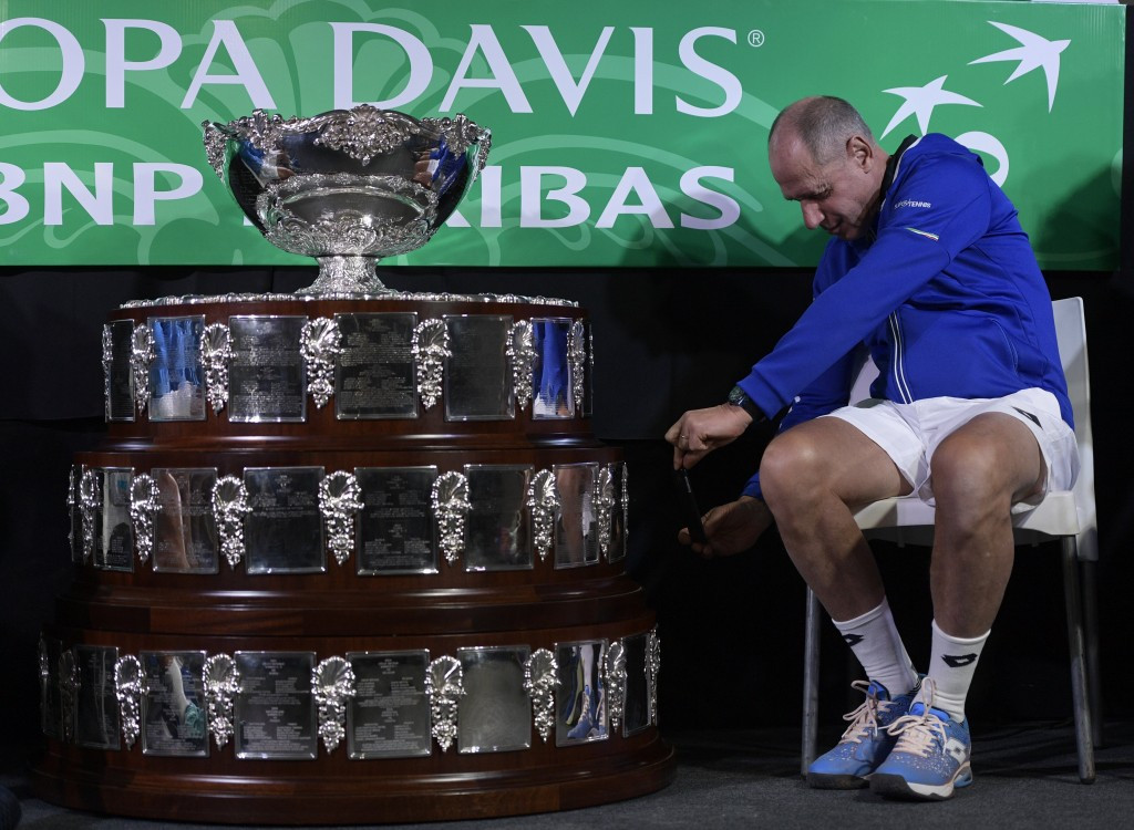 Italian team captain Corrado Barazzutti takes a picture of the trophy ©Getty Images