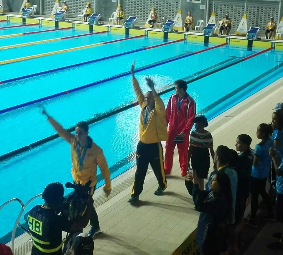 Ryan Pini triumphed in the men's 100m butterfly event to the delight of the home crowd