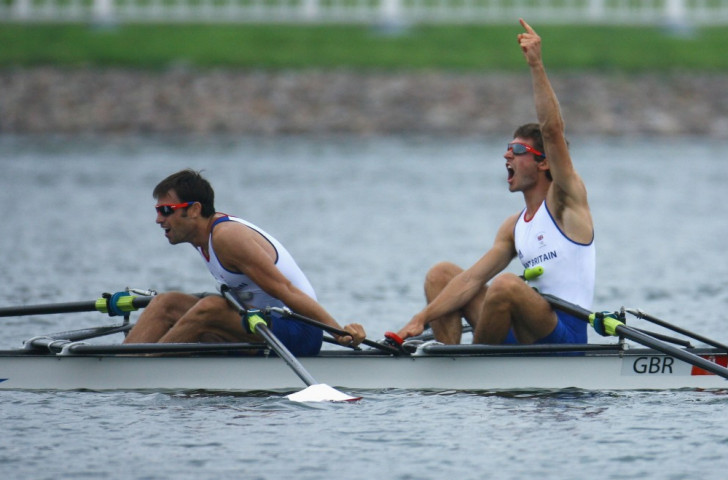 Mark Hunter, pictured left with Zac Purchase after winning the men's lightweight double sculls gold at the Beijing 2008 Games, believes lightweight rowing - and FISA - is being unfairly squeezed by the IOC over future Olympic boat classes ©Getty Images