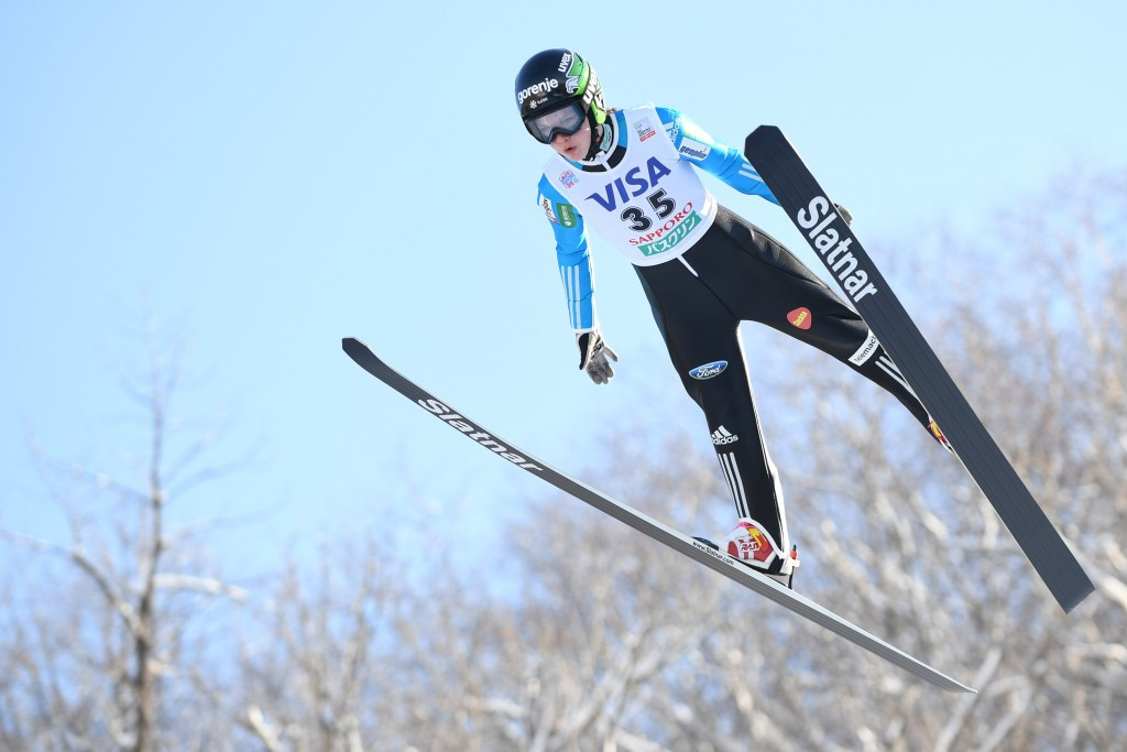 Ema Klinec helped Slovenia defend their mixed team normal hill ski jumping crown ©Getty Images