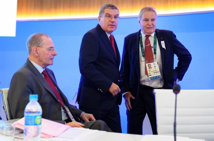 Swiss IOC member and former FISA President Denis Oswald, pictured right during the Rio Games along with the past and present IOC Presidents, Jacques Rogge, left, and Thomas Bach, told FISA delegates in Tokyo that Bach had warned him against an increase in lightweight rowing ©Getty Images