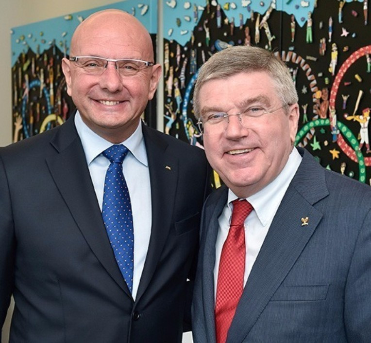 IBSF President Ivo Ferriani, pictured left with IOC President Thomas Bach, is under pressure to act strongly against Russian athletes accused of doping - but he insists more proof is required before judgements are made ©Getty Images
