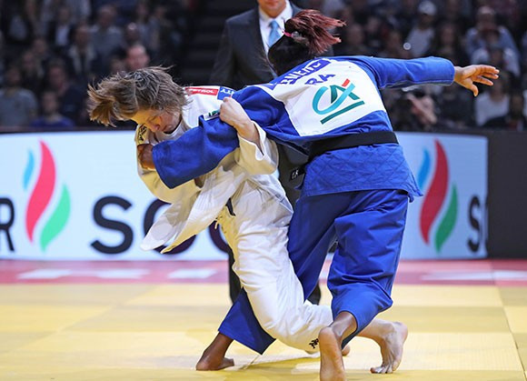 Tina Trstenjak of Slovenia, left, was another newly-crowned Olympic champion to secure gold in the season-opening event ©IJF