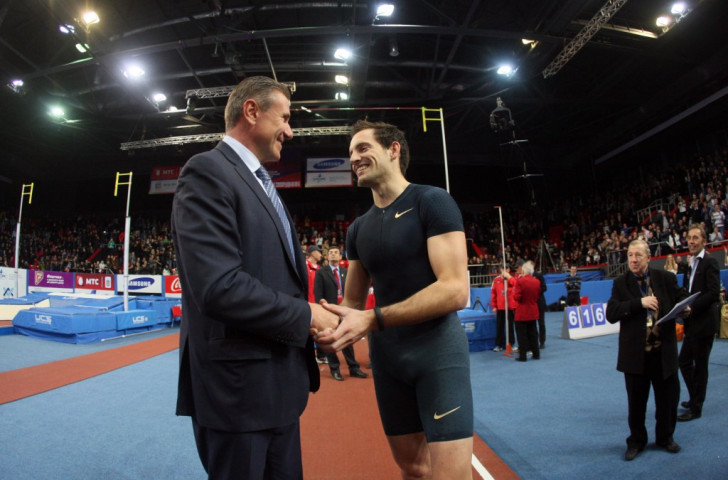 Renaud Lavillenie has backed Sergey Bubka - pictured congratulating him in Donetsk last year after he had broken his longstanding pole vault world record  - for the IAAF Presidency next month
