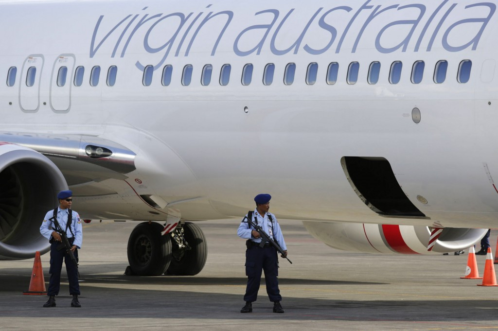 Indonesian police stand guard after a Virgin flight from Australia was diverted in 2014 ©Getty Images