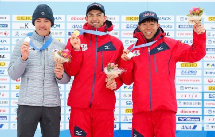 Akira Lenting, centre, won the men's 10km classical event ©JOC/Twitter
