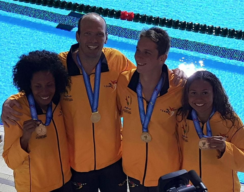 The Papua New Guinea relay team scooped the 4x50m honours thanks largely to a superb last leg from Ryan Pini