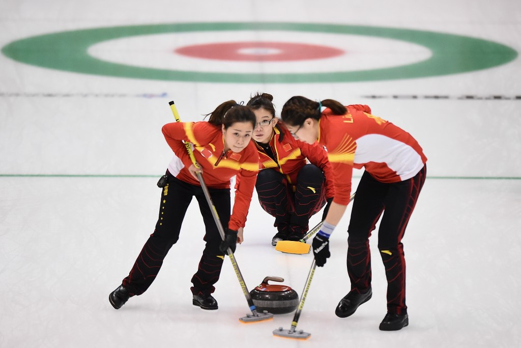 China sweep the ice during their victory over South Korea ©Getty Images