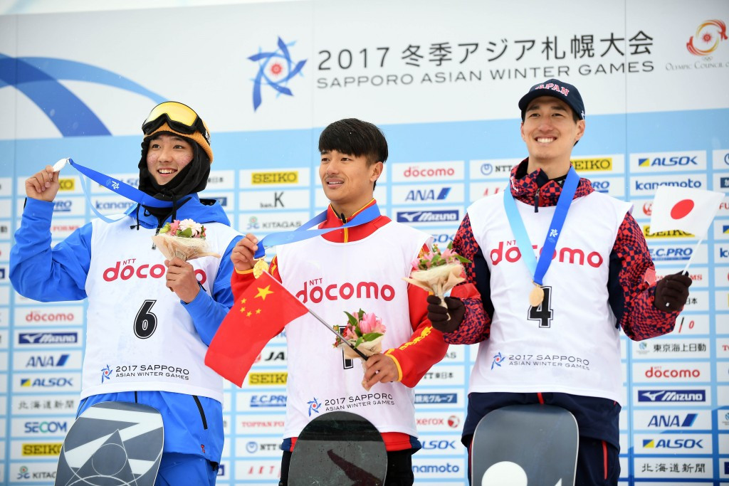 Zhang Yiwei of China, centre, won the men's halfpipe competition at the Asian Winter Games ©Getty Images