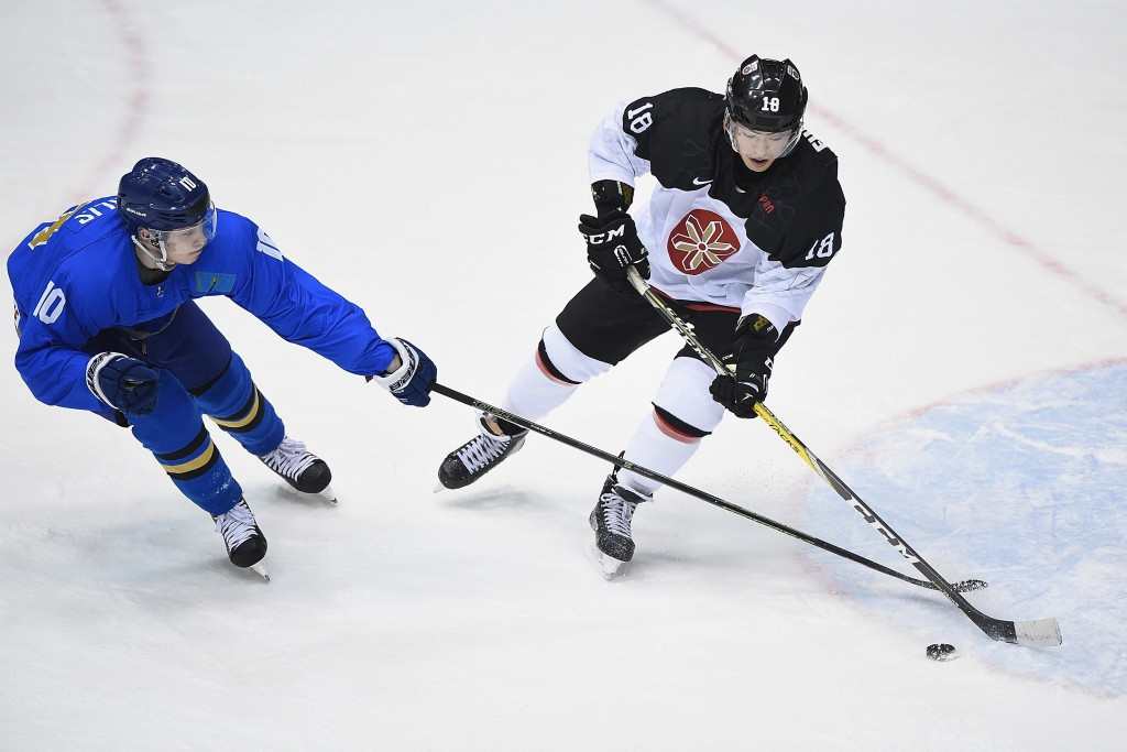 Takuma Kawai of Japan, right, and Nikita Mikhailis of Kazakhstan battle for the puck ©Getty Images