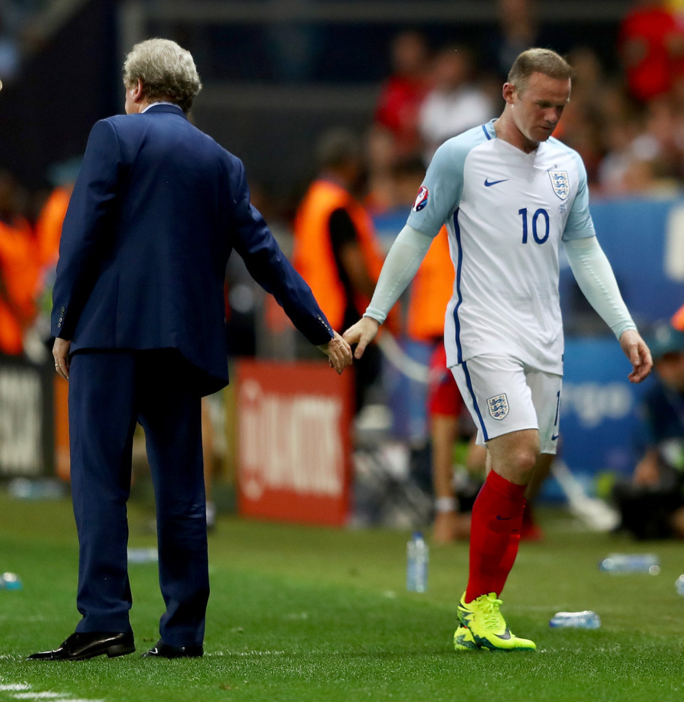 Former England manager Roy Hodgson shakes hands with the national team captain Wayne Rooney during England's loss to Iceland at Euro 2016 in France ©Getty Images
