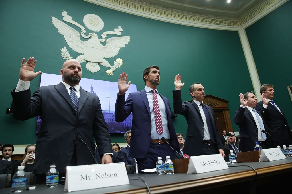 Five people, including 23-time Olympic gold medallist Michael Phelps, second from left, gave evidence at a Congressional Sub-Committee hearing in Washington D.C. ©Getty Images