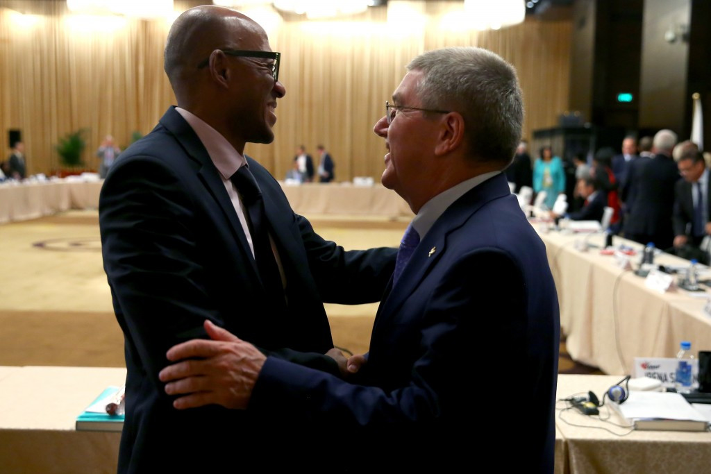 Frankie Fredericks, left, denies wrongdoing after an investigation was launched into payments a company linked to him allegedly received three days before the 2016 Olympic and Paralympics were awarded to Rio de Janeiro ©Getty Images