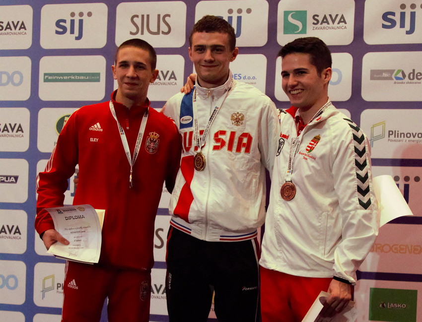 Andrei Golovkov of Russia, centre, also won the gold medal today in the 10m air rifle junior event at the European Shooting Championships in Maribor today ©ESC