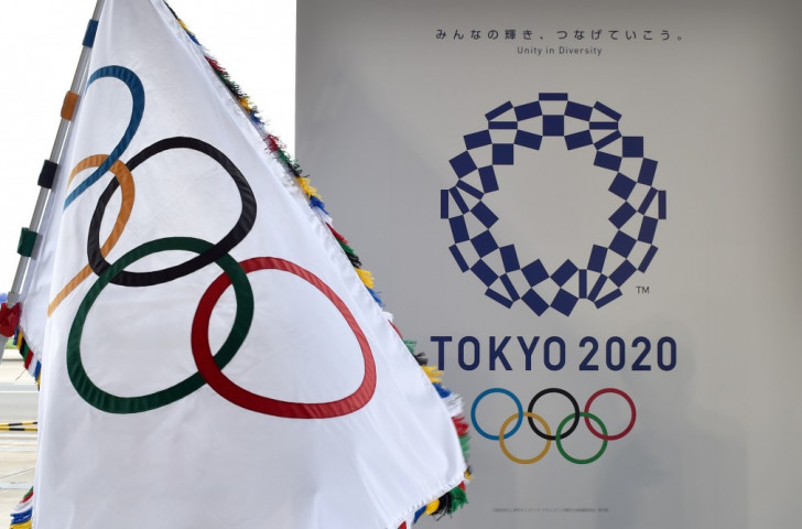 The revised Tokyo 2020 logo, pictured alongside the Olympic flag, arrived after a long and difficult process. Will the process of deciding on the Games mascot, which the public can choose but not name, prove any smoother? ©Getty Images