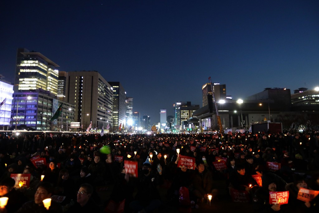 Protesters celebrate the court's verdict today in Seoul ©Getty Images